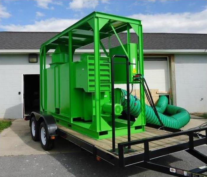 Large size drying equipment on top of attached trailer.